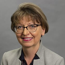 Headshot of author and ICF CEO Magda Mook