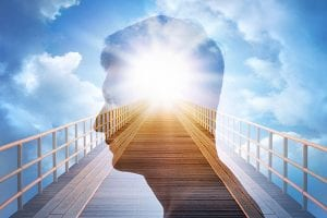 double exposure of man's profile on top of sunny sky