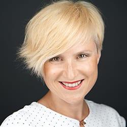 Headshot of author Mojca Korelca